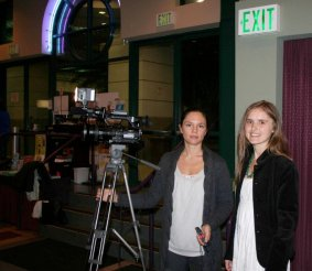 "Daria (right) with journalist and videographer for Reuters filming interviews with attendees at the screening for ""Punctured Hope"" in the cinema in Los Angeles for a Reuters' Special Feature about the film."