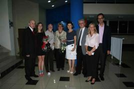 "Romanian Ambassador to Cuba Dr. Dumitru Preda, Daria, Mrs. Preda (4th from left), followed by Hungarian and Austrian Ambassadors to Cuba and their respective wives. The photo was taken after the cinema screening of the feature documentary ""Brasov: Probably the Best City in the World"", produced by Daria and directed by Bruno."