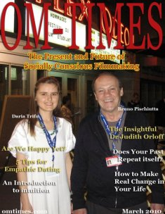 "Daria and Bruno on the cover of OM-Times Magazine. Photo taken in front of the cinema in Montreal where their feature film ""Punctured Hope"" was screened in competition during the Montreal World Film Festival. Daria! magazine was widely distributed."