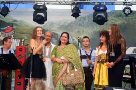 Daria introducing Bangladeshi filmmakers, guests of the Global Nonviolent Film Festival, on the stage of the Oktoberfest in Brasov, Romania in front of thousands of attendees and cameras. Daria! magazine was widely distributed.