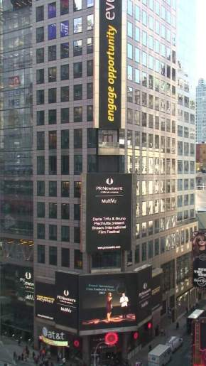 Daria and Bruno appear on the Reuters gigantic screen in Times Square, New York City.